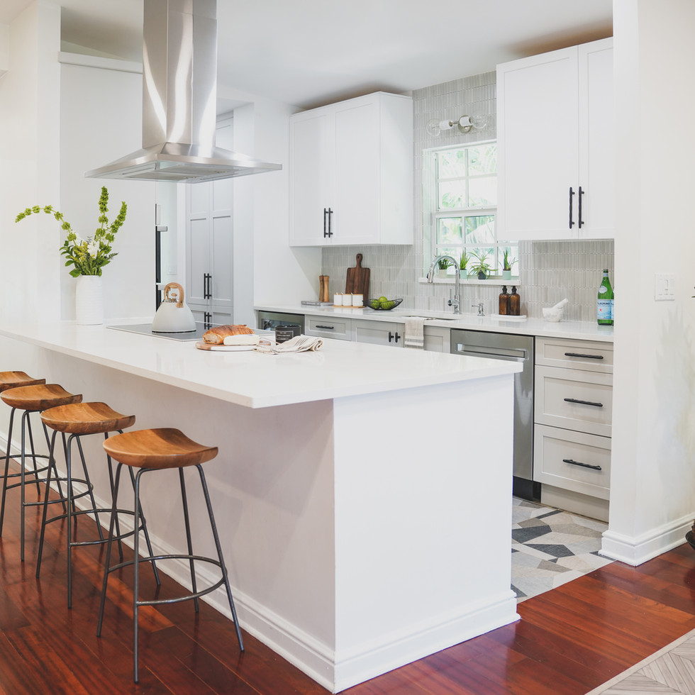 Bright, white and airy galley kitchen in Coconut Grove, FL showcases bold patterned flooring and a Ann Sacks backsplashBright, white and airy galley kitchen in Coconut Grove, FL showcases bold geometric flooring from Floor and Decor and a Ann Sacks backsplash