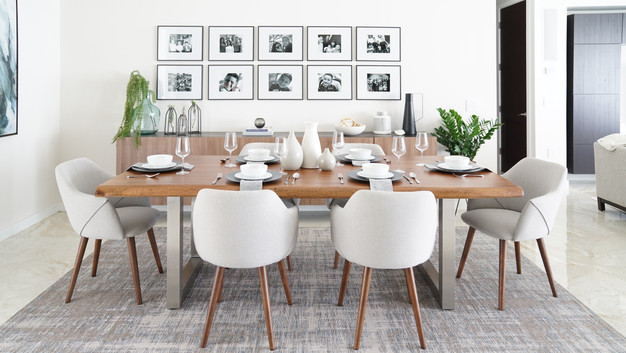 Modern dining room with accent gallery by Miami based interior designer KJ Design Collective