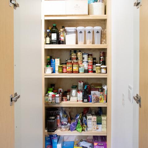 Modern kitchen with walk in pantry designed by Miami based interior design studio KJ Design Collective