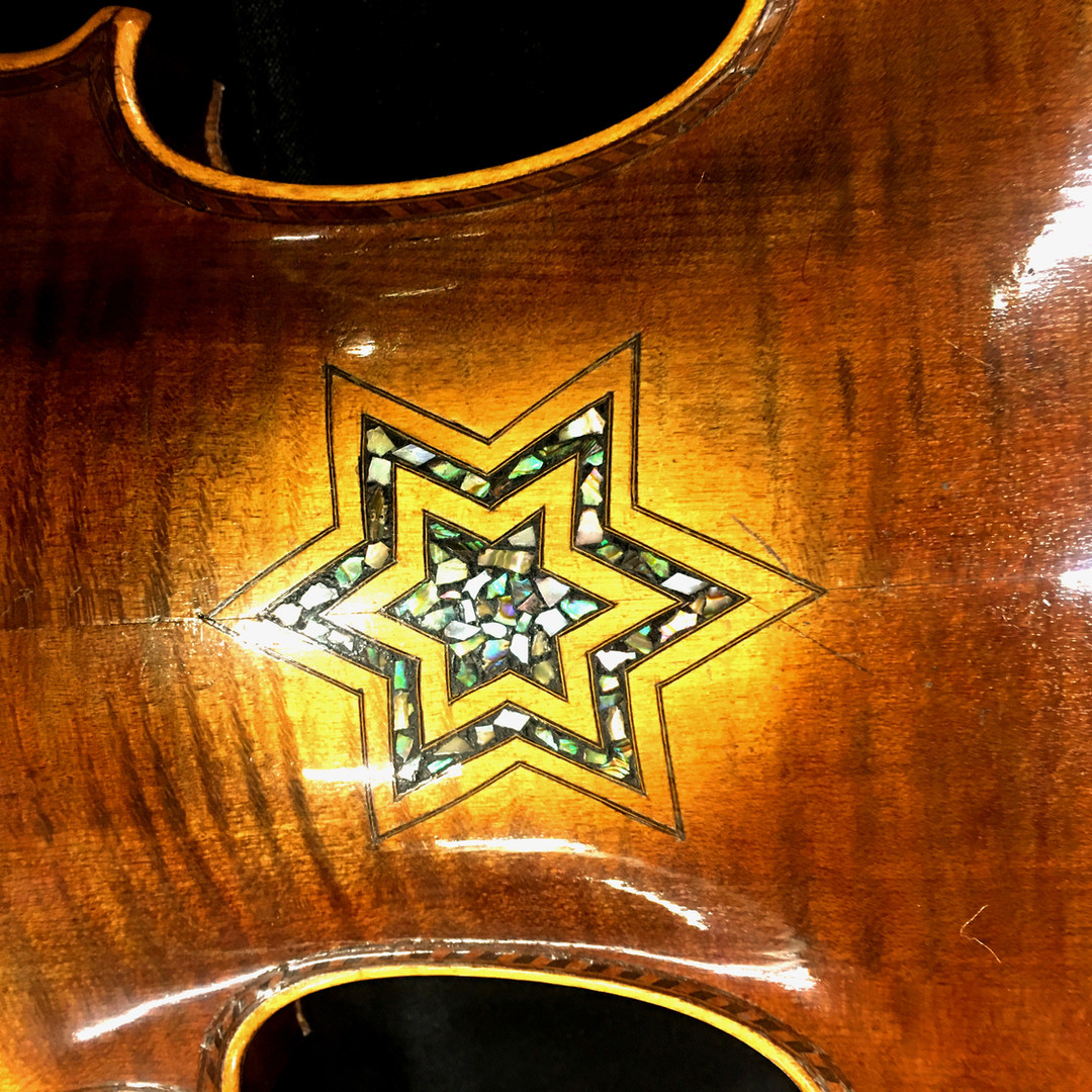 A close-up on a Star of David decorating one of the violins of hope.