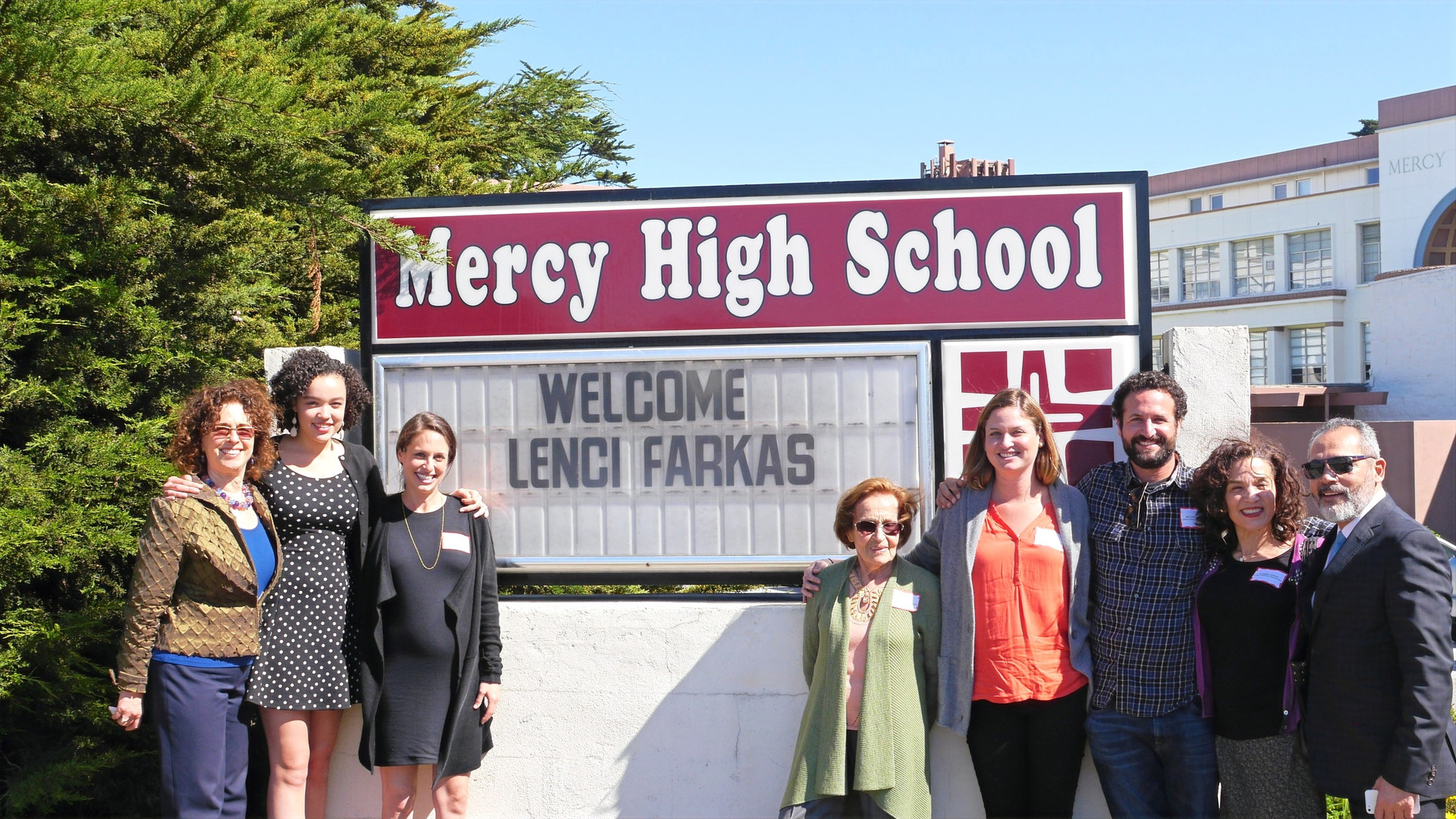 Courage & Spirit 2016 Honoree Lenci Farkas stands with her family in front of Mercy SF High School.