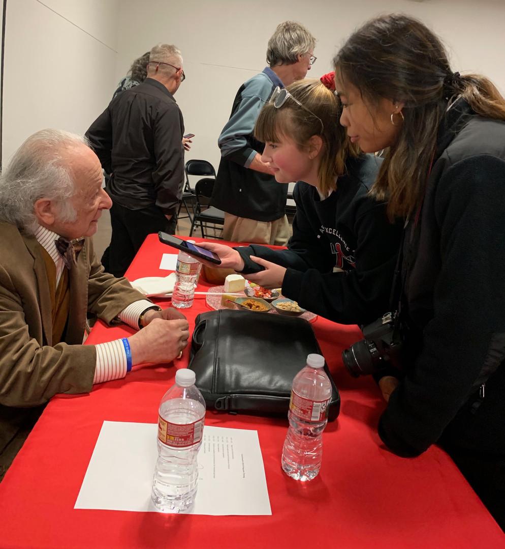 Mercy High School students speak with Holocaust survivor Paul A. Schwarzbart at the 2019 Kristallnacht Commemoration.