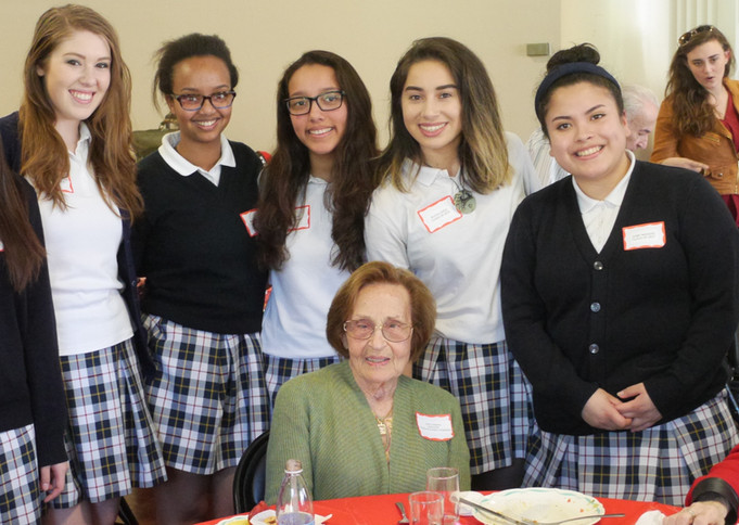 Holocaust survivor Lenci Farkas surrounded by Mercy student volunteers at the annual Courage & Spirit luncheon.