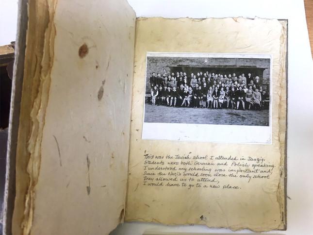 Auschwitz survivor Lenci Farkas's school picture with a short descriptive journal entry.