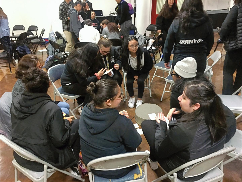 Students partner in written responses to survivor stories.