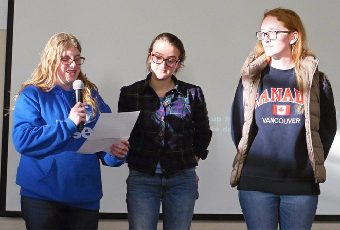 Former Student Farkas Board Members Sydney Klaiman and Morgan Hildula, along with another Mercy High School student, present historical content at the 2018 Kristallnacht Commemoration. High schoolers presented in a series of break-out sessions that connected the Holocaust to other catastrophes around the world.