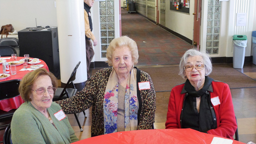 Holocaust survivors Lenci Farkas, Helen Farkas, and Lily Spitz pose at Mercy High School after the Courage & Spirit Luncheon.