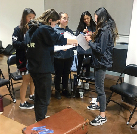 During the 2019 Kristallnacht event at Mercy High School, participants created poetry in groups based on their reflections of survivor testimonies. The full body of participants then took turns reading their poems aloud, together creating a moving poem.
