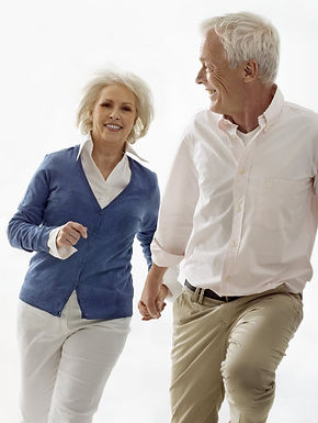older couple holding hands and walking