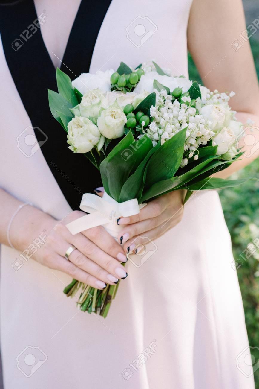 Du muguet dans le bouquet de mariée