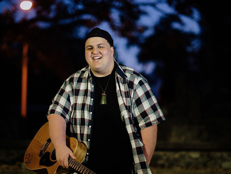 Judah Kelly's easy charm, stinging guitar and soulful voice