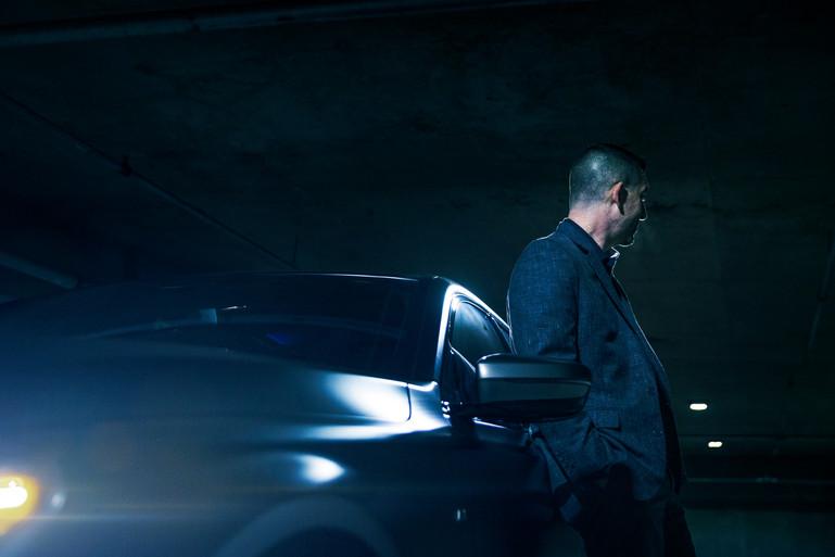 BMW M7 Leaning On Car