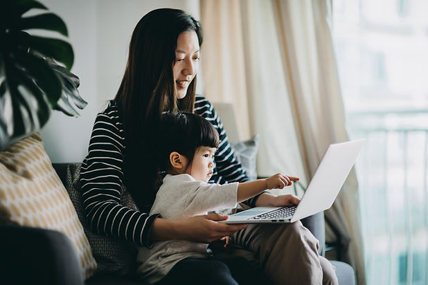 Mother and child watching a laptop screen