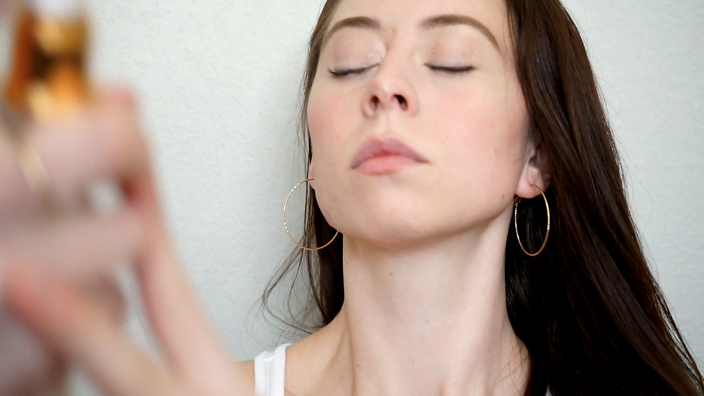 Applying Farsali Rose Gold Skin Mist