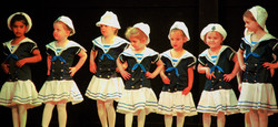 Young tap dancers dressed as sailors