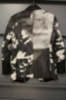 The jackets of vandalism created by Stephen Calcutt for his fashion brand Mango Ha Ha Ha.  A tuxedo style jacket that has a vibrant print derived from the graffiti etched windows of a bus shelter. Each jacket is tailor made and bespoke