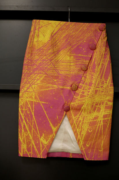 A skirt of vandalism created by Stephen Calcutt for his fashion brand Mango Ha Ha Ha.  A formal design style skirt that has a vibrant print derived from the graffiti etched windows of a bus shelter. Each skirt is tailor made and bespoke