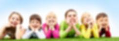 Kids-on-Grass-Smiling-Banner.jpg