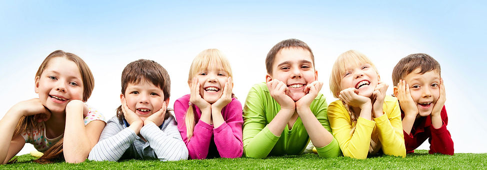 Kids-on-Grass-Smiling-Banner.jpg