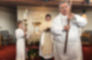Worship service assistants acolytes priest procession
