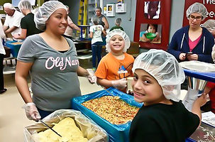 Hunger charity outreach fellowship Feed My Starving Children FMSC food packing