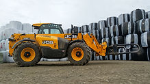 JCB with Round Bales