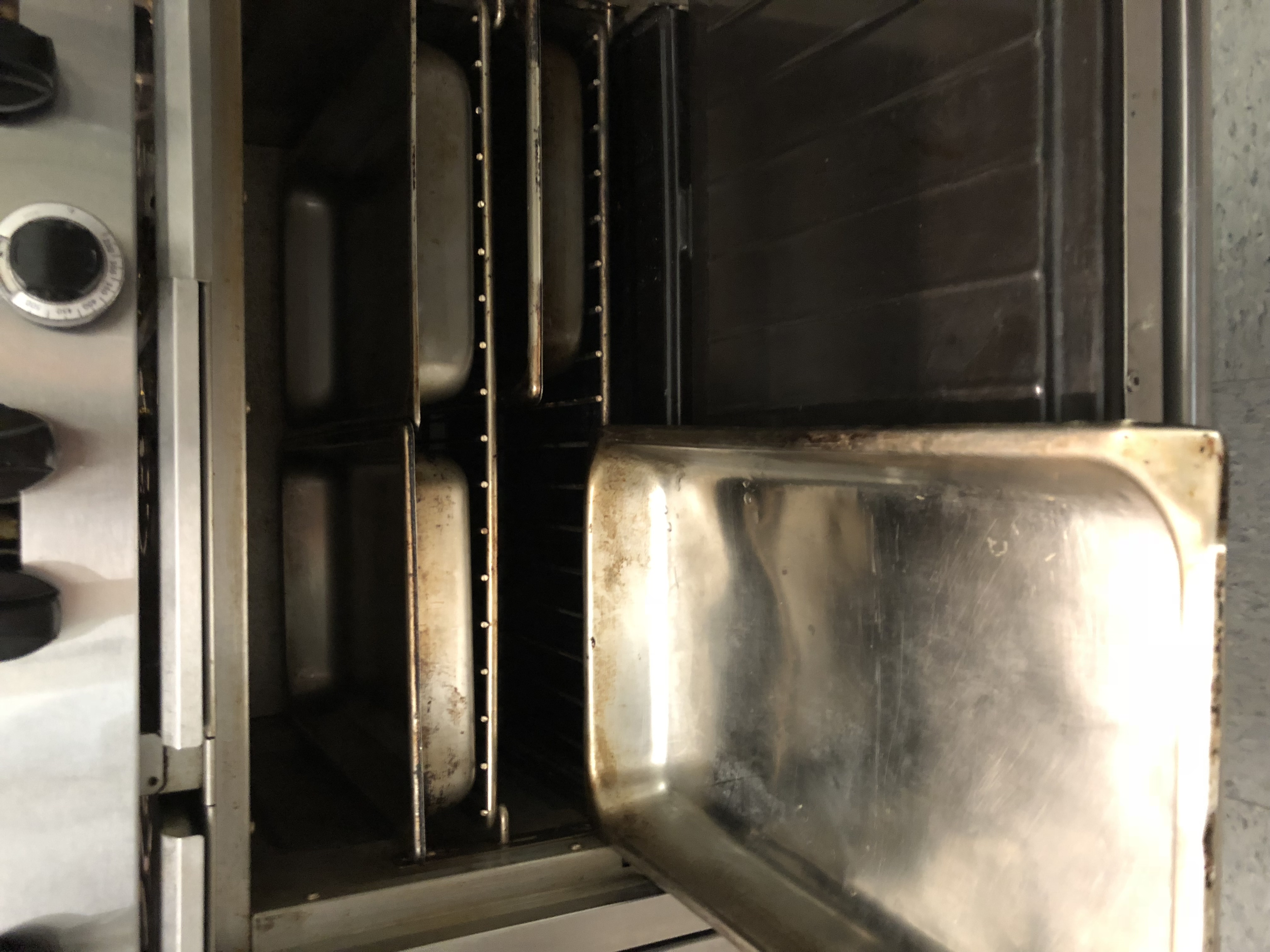 4 Large Hotel Pans in gas oven