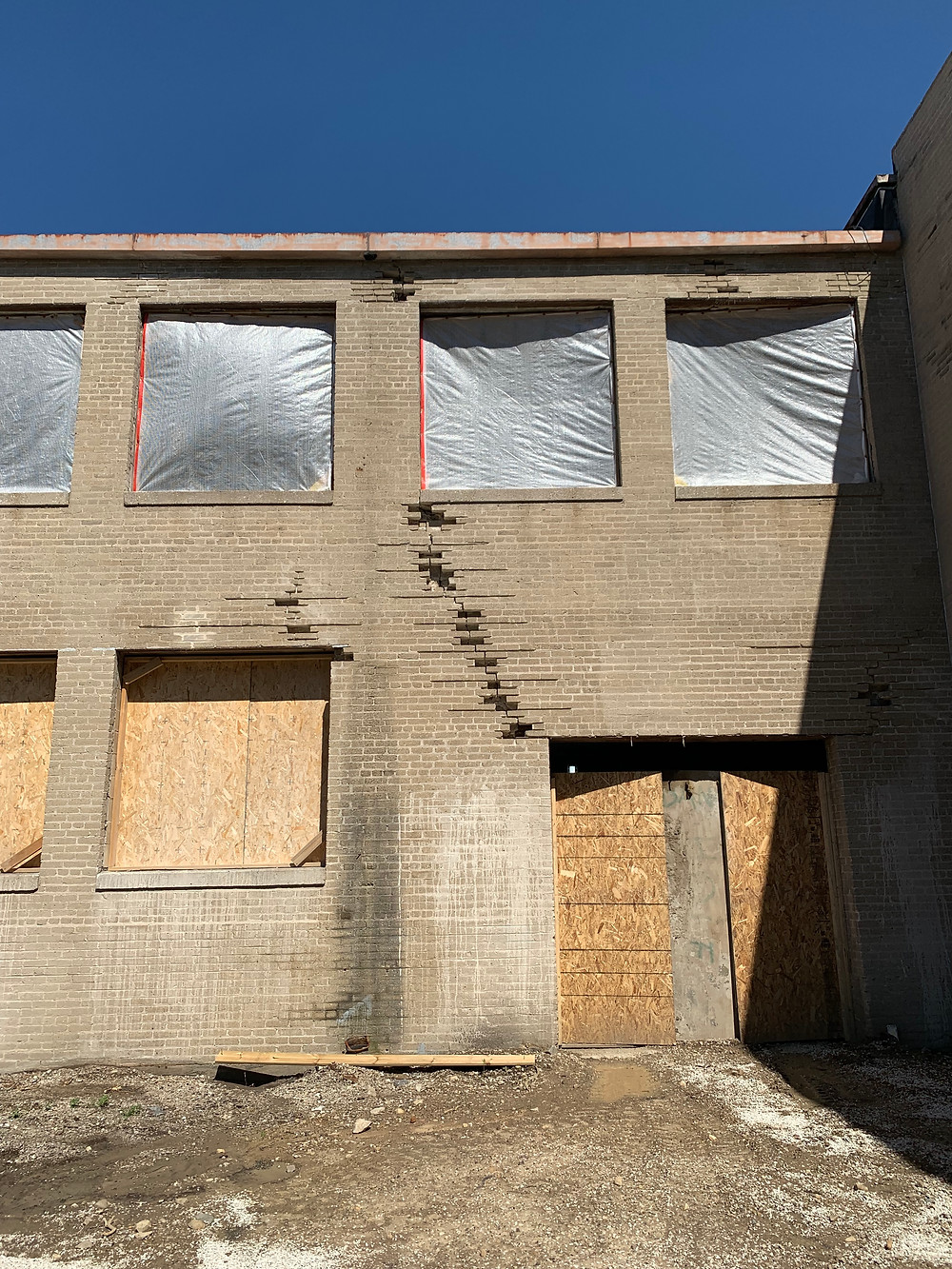 Exterior of boarded-up Briggs & Stratton factory to be rehabilitated into housing in Milwaukee