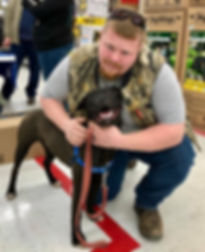 Dog adopted at Tractor Supply