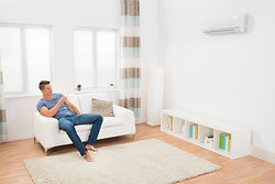 Man turning off air conditioner