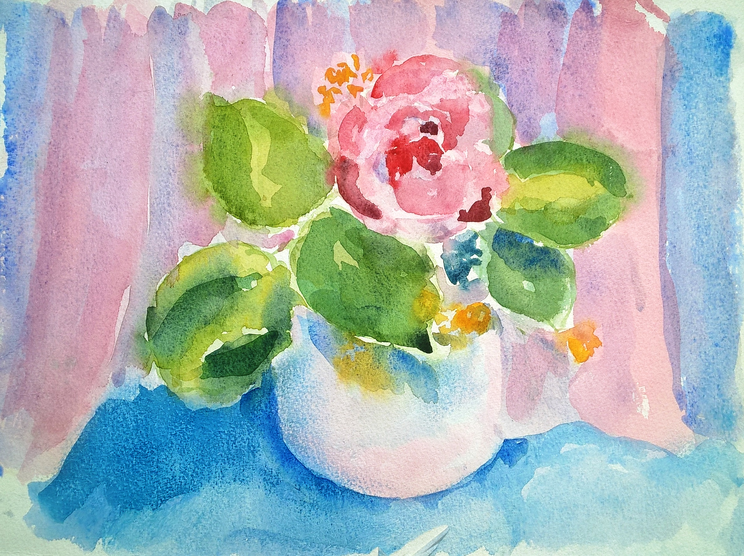 Rose in pink bowl