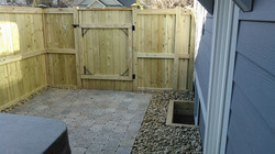 pavers and gravel in enclosure