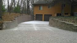 retaining walls flank concrete drive