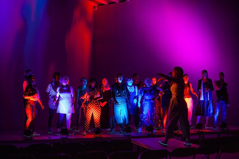 Multi-coloured lights illuminate F*Choir at the KODE 2 concert