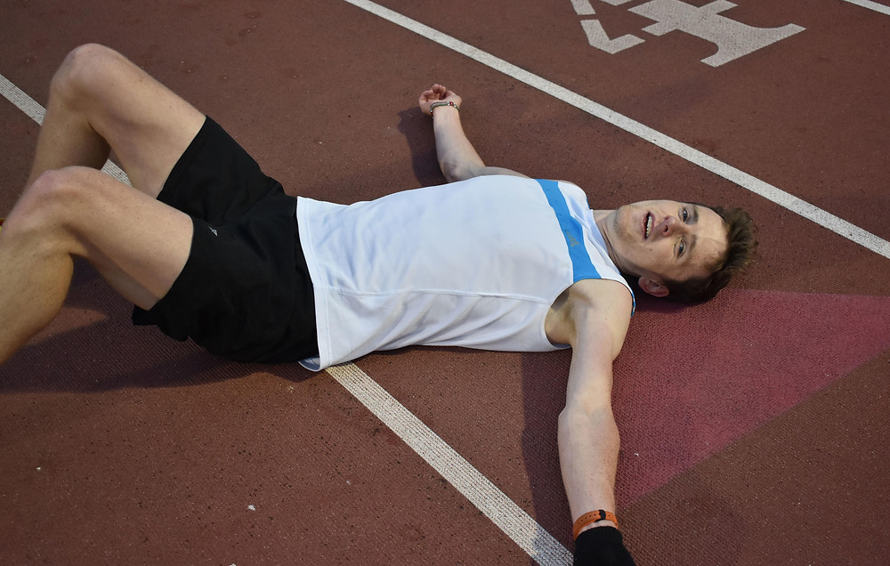 The author recovers after setting an Irish beer mile record. EKATERINA MOYSOV