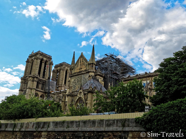 The damages of NOtre Dame as can be seen from River Sienne