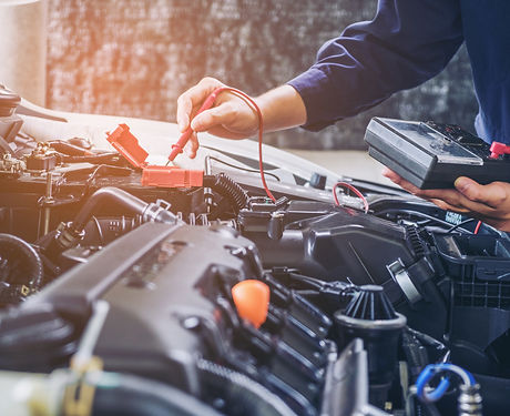 Hands of car mechanic  working in auto r