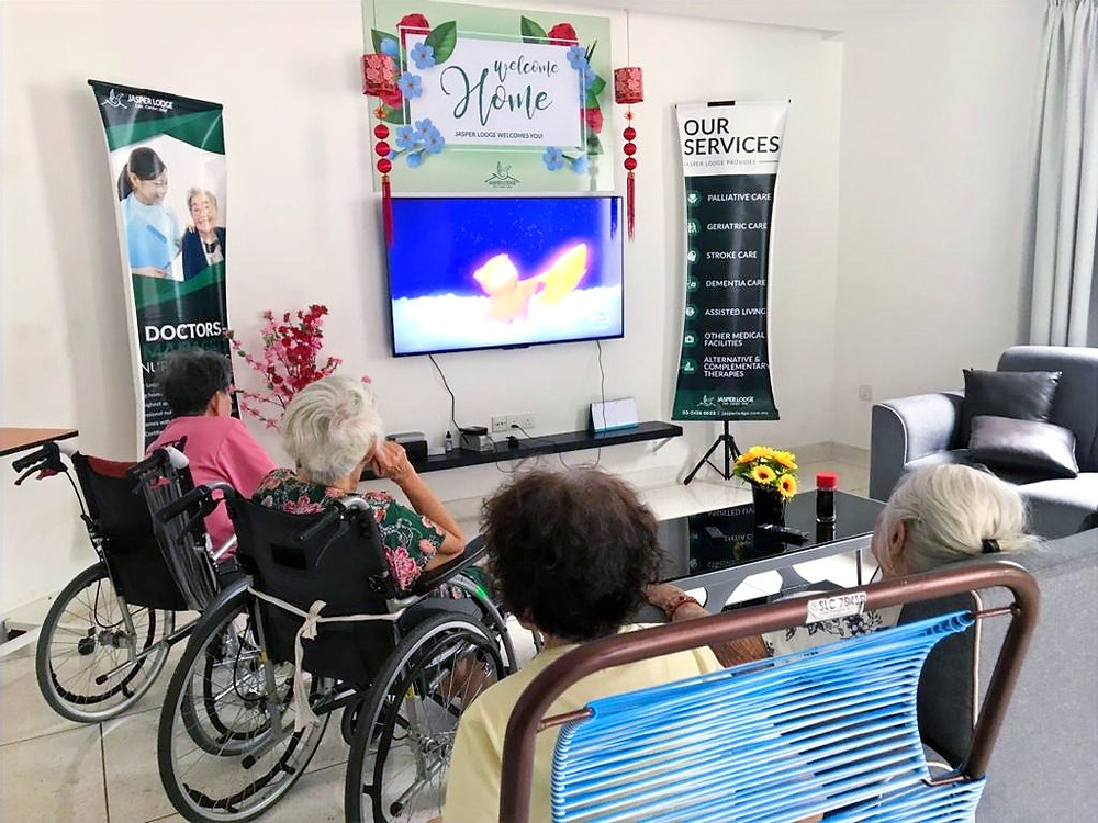 Residents watching television programs together at Jasper Lodge Johor Bahru