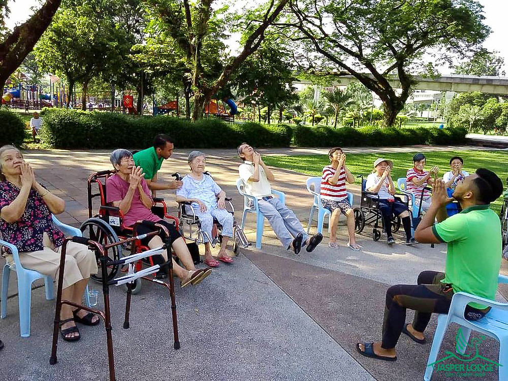 Elderly group exercise outdoor in the park by Jasper Lodge physiotherapists
