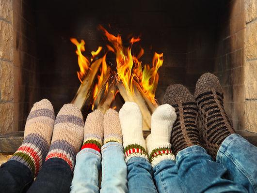 Feets of a family wearing woolen socks w
