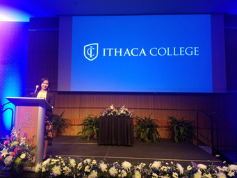 Jamie Shum at a speaking gig during the 2018 Ithaca College Alumni Weekend.