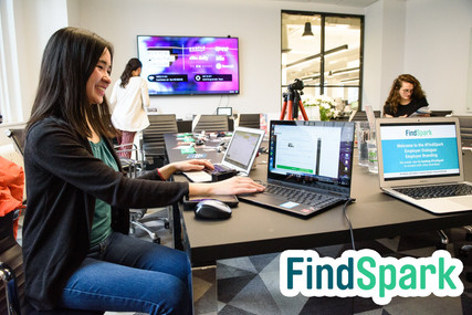 Jamie Shum handling on-site logistics for FindSpark's Employer Dialogue on Employer Branding panel discussion event at Bustle's HQ in NYC on April 30, 2019.