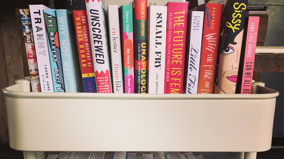 A colorful stack of books with the spine faced forward.