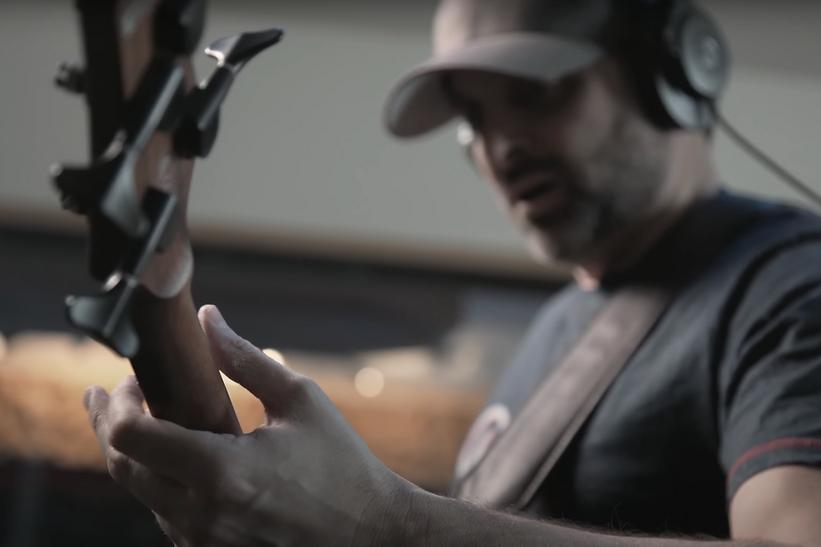 JRTheBand playing acoustic guitar.