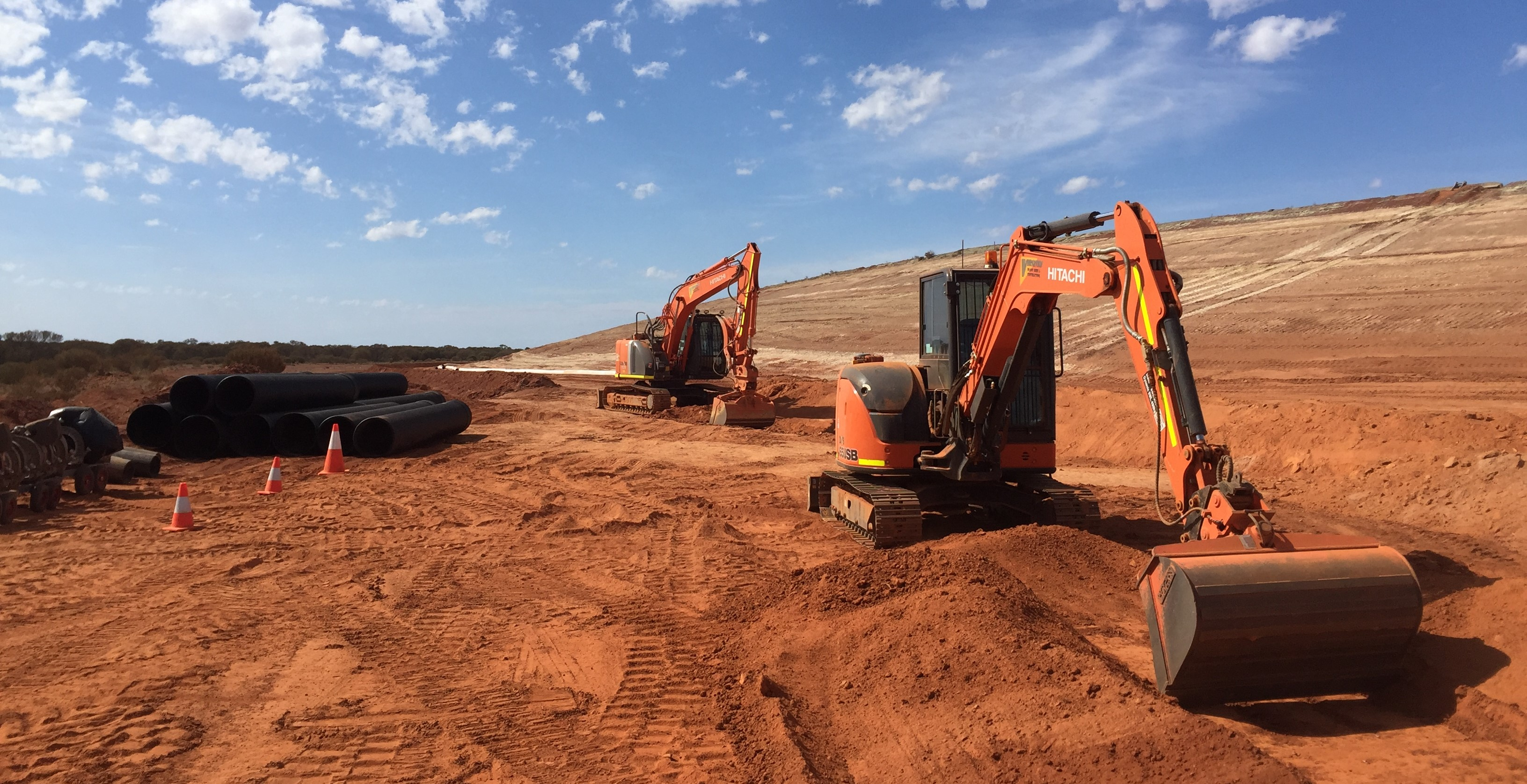 Hitachi excavators laying culverts