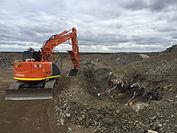 Excavator at landfill