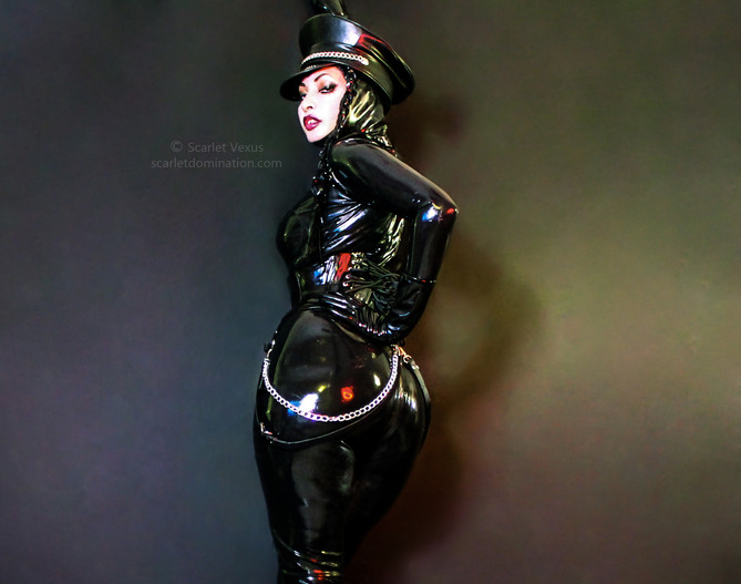 Mistress Scarlet Vexus in a latex catsuit