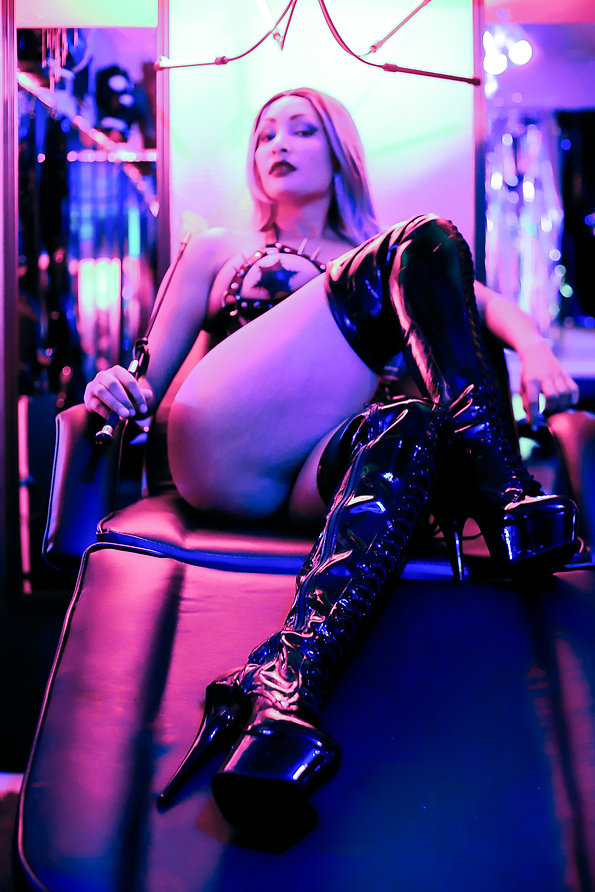 kinky dominant femme lounging on a bondage bed in her dungeon - Dom, Top, submission, role play fetish