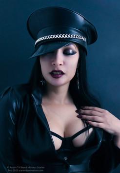 Mistress Scarlet Vexus - A Fetish BDSM Femdom Dominatrix Poses for a Portrait
