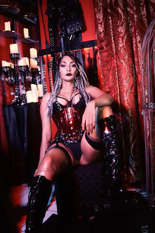 Beautiful Ornate dungeon and Mistress photo in corset and wearing fetish boots